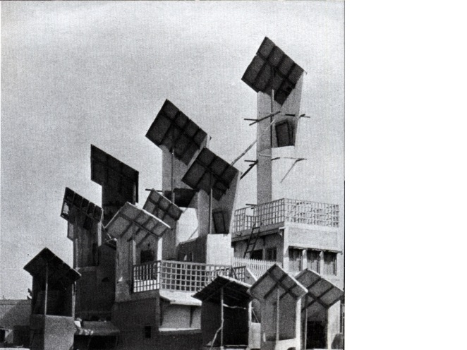 "Hyderabad, Sindh, southern Pakistan; not Hyderabad, Andhra Pradesh, south India. Images from Bernard Rudofsky, Architecture without Architects, New York, Museum of Modern Art, 1964: windscoops (called bad-gir by Rudofsky, müg by Wikipedia) on the roofs of buildings, which channel air into their interiors. ""In multistoried houses they reach all the way down, doubling as intramural telephones. Although the origin of this contraption is unknown, it has been in use for at least five hundred years."""